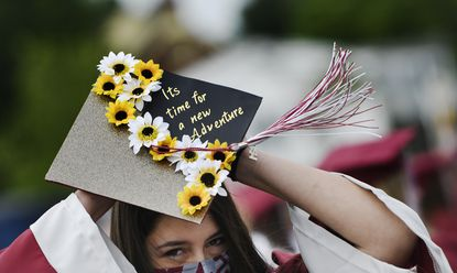 Erika Vasquez puts on her mortarboard before filing into Winters Mill's graduation ceremony at the Carroll County Agriculture Center in Westminster Wednesday, June 2, 2021.