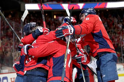 Members of the Washington Capitals mob Nicklas Backstrom after he score the game winning goal in the fourth period giving the Capitals 4-3 overtime win over the Columbus Blue Jackets during Game Five of the Eastern Conference First Round during the 2018 NHL Stanley Cup Playoffs at Capital One Arena on April 21, 2018 in Washington, D.C.