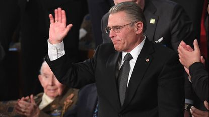 Special guest Tom Wibberley, father of Craig Wibberley, a Navy Seaman killed on the USS Cole, waves as he is acknowledged during the State of the Union address Tuesday night.