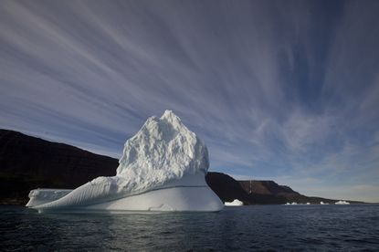 In this July 21, 2011 file photo, an iceberg floats in the sea near Qeqertarsuaq, Disko Island, Greenland. Global warming is shifting the way the Earth wobbles on its polar axis, a NASA study finds.