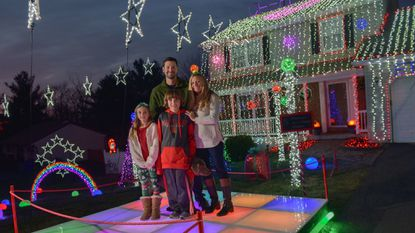 Bryan and Angie Bartlett stage a lighting display on their Ellicott City house for the community and their two kids, Bryson and Brynn.