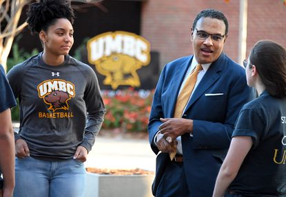 Dr. Freeman Hrabowski is the President of UMBC talks with students, Tyler Moore (L) and Zoee Leckron. Top Workplaces Magazine shoot. October 25, 2019.