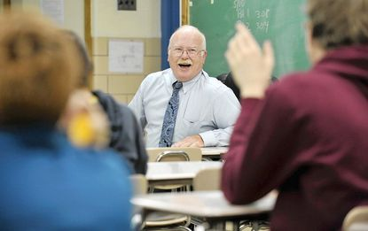 James Fitzpatrick was honored during Teacher Appreciation Week in 2012 at Catonsville High School where he graduated in the 1970s. (Kim Hairston/Baltimore Sun).