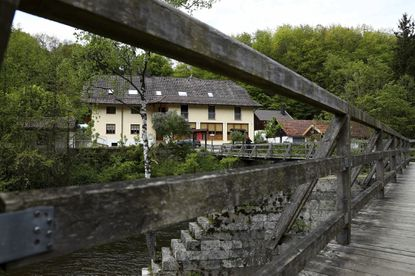 A guesthouse is pictured at the river 'Ilz' in Passau, Germany, Monday, May 13, 2019. Police investigating the mysterious death of three people whose bodies were found with crossbow bolts inside at the hotel in Bavaria on Saturday, May 11, 2019.