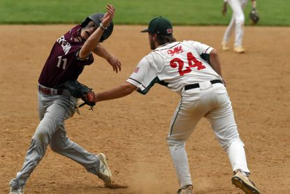 Severn's Sean Ward, left, is unable to avoid a tag by Glenelg Country's Tommy Berbert as he's caught in a rundown at third base during a baseball game at Glenelg Country School on Tuesday, May 4, 2021.