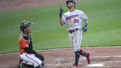Minnesota Twins' Eddie Rosario (20) reacts after hitting a solo home run in the fifth inning of a baseball game against the Baltimore Orioles, Saturday, April 20, 2019, in Baltimore. (AP Photo/Tommy Gilligan)