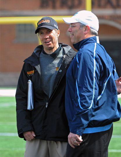 North Carolina men's lacrosse coach Joe Breschi, right, talks to Maryland coach John Tillman after a game at Byrd Stadium.