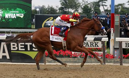 Justify (1), with jockey Mike Smith up, crosses the finish line to win the 150th running of the Belmont Stakes.