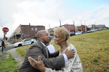 Zatella Giles greets City Council President Jack Young.
