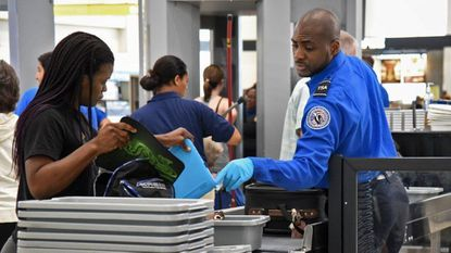 Travelers go through security screening at BWI Airport in a 2017 file photo.