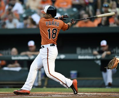 Orioles' Gerardo Parra follows through on a double against the Detroit Tigers during the first inning, Saturday, Aug. 1, 2015, in Baltimore.