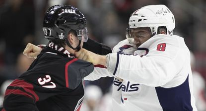 Washington Capital's Alex Ovechkin (8) fights with Carolina Hurricanes' Andrei Svechnikov (37) during the first period of their first round Stanley Cup game on Monday.