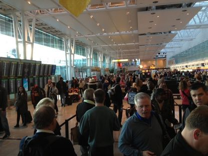 Travelers were faced with long security checkpoint lines Friday morning.