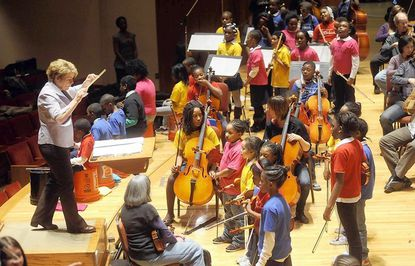 Conductor Marin Alsop leads a rehearsal of Orchkids, practicing with the Baltimore Symphony Orchestra at the Meyerhoff Symphony Hall.
