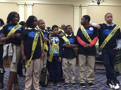 During a rally to increase police accountability in Annapolis, 10 children were draped in CAUTION tape. Members of the House of Delegates Judiciary Committee held hearings on police reform bills Tuesday.