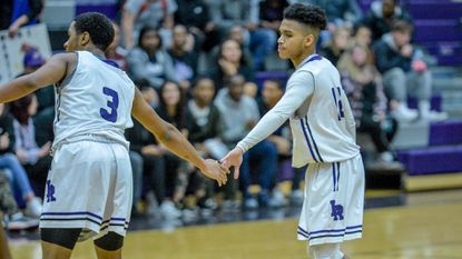 Carey Olivis and Elijah Modeste, seen congratulating one another during a game against South Carroll on Feb. 15, helped Long Reach secure a comfortable victory over Howard on Monday night.