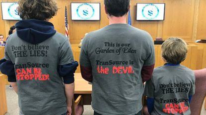 Members of the Ayd family - Frank Ayd V, left, Frank Ayd IV and Johnathan Ayd - of New Park, Pa., wear their shirts opposing Transource Energy's proposed power line project through northern Harford County and southern Pennsylvania.