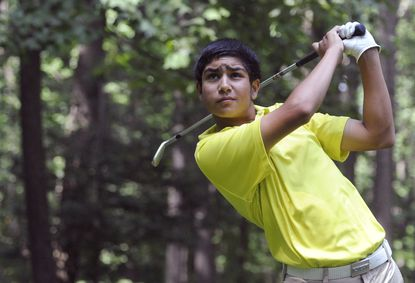 Rij Patel, 14, practices his golf swing in his backyard. The Hunt Valley Golf Club member is the No. 1 golfer in the 14-and-under division of the International Junior Golf Tour, a prestigious circuit that has produced such professional standouts as Rickie Fowler, Hunter Mahan and Paula Creamer.