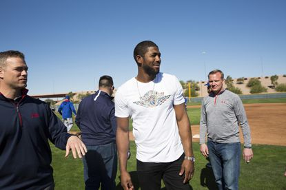 Chicago Cubs President of Baseball Operations Theo Epstein talks to Dexter Fowler during a surprise appearance at spring training at Sloan Park in Mesa, Ariz., on Thursday, Feb. 25, 2016, after Fowler agreed to a one-year contract with a mutual option with the Cubs. (Armando L. Sanchez/Chicago Tribune/TNS) ** OUTS - ELSENT, FPG, TCN - OUTS **
