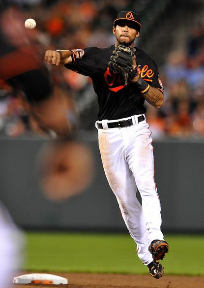 Baltimore Orioles second baseman Robert Andino throws out Tampa Bay Rays' Ben Zobrist during the ninth inning of a baseball game on Friday, May 11, 2012, in Baltimore. The Orioles won 4-3. (AP Photo/Gail Burton)