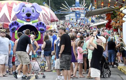 Carnival-goers pack the midway of the Mount Airy fire company carnival July 26, 2016.