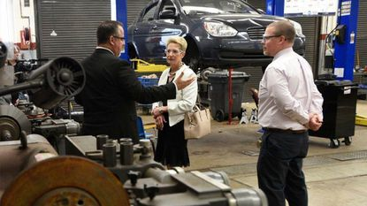 With Carroll County Public Schools Superintendent Steven Lockard, left, and Carroll County Career and Technology Center Principal William Eckles, State Superintendent of Schools Karen B. Salmon visits an automotive services class at the Tech Center in Westminster, Tuesday.