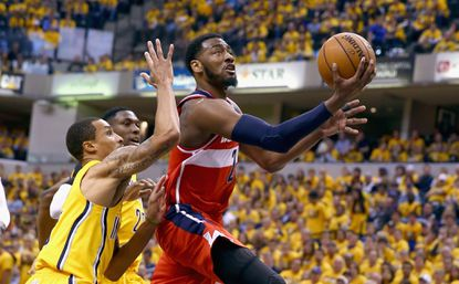 John Wall goes in for a layup against the Indiana Pacers in Game 1.