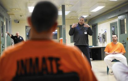 Greg Hendricks, a peer recovery support counselor from the Carroll County Health Department, speaks with participants in the drug treatment program at the Carroll County Detention Center in Westminster, including Louis Vicarini of Westminster, right, Wednesday, Dec. 23, 2015.