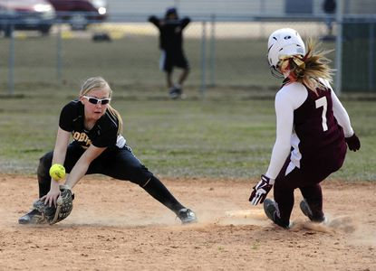 Harford Tech's Sarah North can't hold on to the throw as she turns to attempt the tag on Havre de Grace baserunner Hailey Bethke during Saturday's James R. Harris Memorial Softball Tournament at Stancil Park in Havre de Grace