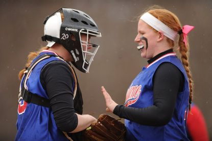 Lansdowne's Jordyn Goodman, right, gets the game ball from her older sister Hannah Goodman after pitching a perfect game against Western Tech.