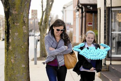 Monica Mutschler, left, of Finksburg and her daughter Madilyn, 11, walk down West Main Street in Westminster as they bring Madilyn's crab made with Peeps to the Carroll Arts Center for the center's Annual Peep Show.