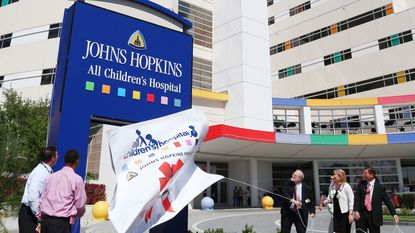 Officials unveil the new name of Johns Hopkins All Children's Hospital in April 2016 in St. Petersburg, Fla.