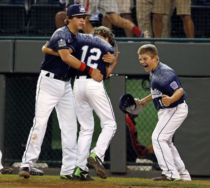 Lewisberry, Pa.'s Jaden Henline (12) celebrates with teammates Cole Wagner, left, and Dylan Rodenhaber after getting the last out of a 3-0 win over Pearland, Texas, in a U.S. baseball game at the Little League World Series in South Williamsport, Pa., Wednesday, Aug. 26, 2015.