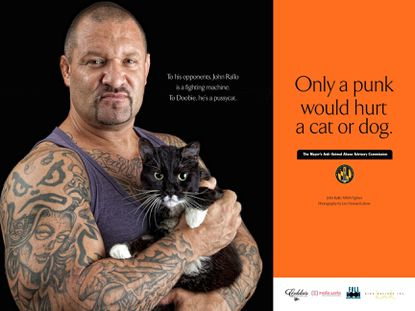 Baltimore MMA fighter and Owner of Shogun Fights, John Rallo shows off his soft side for the animals.