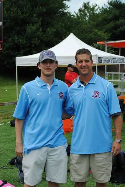 Shootout for Soliders founder Tyler Steinhardt, left, and Baltimore Ravens coach John Harbaugh.
