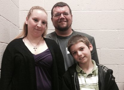 Kimberly and B.J. Welch, and their 9-year-old son Joshua Welch, outside the hearing on Tuesday at Anne Arundel County Public Schools. The family is appealing Joshua's suspension last year from second grade after he bit a pastry into the shape of a gun. A hearing examiner for the school system is hearing the case and will make a recommendation to the school board.