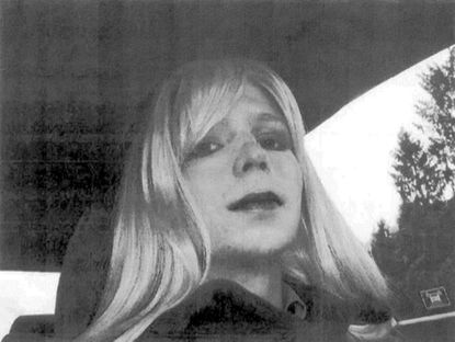 In this undated file photo provided by the U.S. Army, Pfc. Chelsea Manning poses for a photo wearing a wig and lipstick. Defense Department officials say hormone treatment for gender reassignment has been approved for Chelsea Manning, the former intelligence analyst convicted of espionage for sending classified documents to the WikiLeaks website.