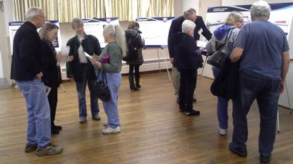 Visitors look over poster boards and chat with Maryland Transportation Authority representatives about the Interstate 95 Express Toll Lane Extension Project during a public information meeting held Monday afternoon and evening at the Joppa-Magnolia Fire Hall.