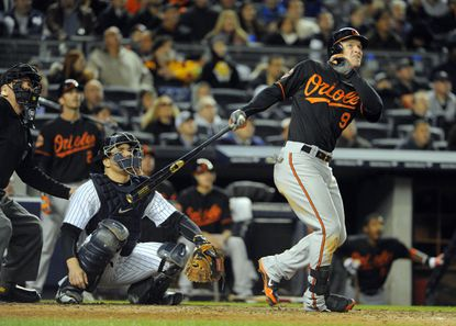 Orioles' Nate McLouth watches a long fly ball just go foul in the top of the 6th inning.