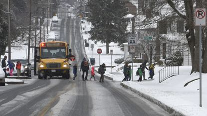 Students are shown getting off a school bus in Westminster in this file photo. Carroll County Public School students were dismissed three hours early on Tuesday, Jan. 29 because of snow in the forecast.