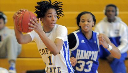 Coppin State forward Janelle Lane (1) turns with the ball, in front of Hampton Pirates forward Brielle Ward (33) during MEAC women's basketball at the Physical Education Complex on Feb. 1, 2014