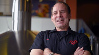 """Flying Dog CEO Jim Caruso, photographed at the Frederick brewery in March 2016, said in a statement the company's plans to build a new brewery are on """"permanent hold."""""""