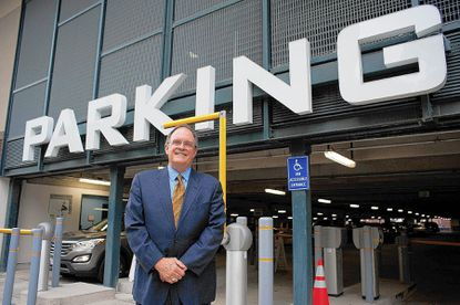 Chief Executive of Baltimore County Revenue Authority Ken Mills stands at the entrance of the new Towson Square parking lot on Virginia Avenue. The revenue authority recently instituted changes in downtown Towson parking fees with the dual goals of maximizing parking spaces and avoiding the gridlock.