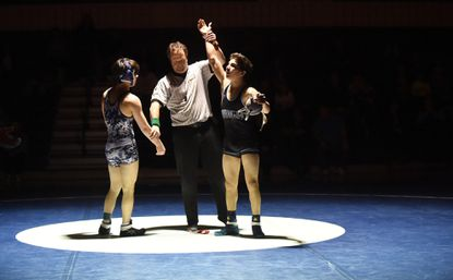 C. Milton Wright's James Riveira, right, has his arm raised in victory after defeating Bel Air's Brent Lorin in the 120 weight class during the finals of the 3A North regional dual meet wrestling tournament at Bel Air High School on Thursday, Feb. 8.