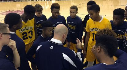 The Chapelgate boys basketball team huddles together during a game against Glenelg Country earlier this season.