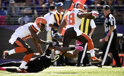 Ravens safWill Davis (39) tries to tackle Browns wide receiver Taylor Gabriel (18) as fellow Browns wide receiver Travis Benjamin (11) tries to assist.