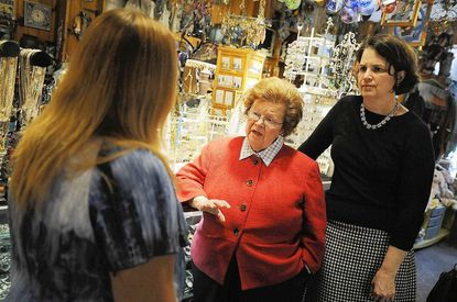 Salley Fox Tennant, left, owner of the Ellicott City store Discoveries, talks with U.S. Sen. Barbara Mikulski, center, and County Councilwoman Courtney Watson about issues facing Ellicott City merchants during a tour of Main Street Ellicott City businesses.
