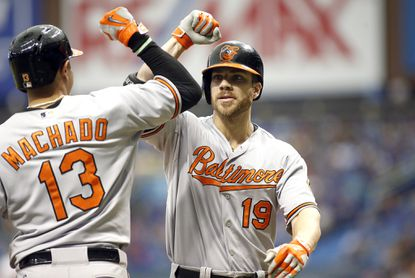 Orioles slugger Chris Davis (19) celebrates his two-run home run with teammate Manny Machado (13) during the third inning on Sept. 20, 2015 at Tropicana Field in St. Petersburg, Fla.