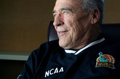 FILE - Jim Phelan, head coach of the Mount St. Mary's men's NCAA college basketball team, ponders his future in his office, in this Wednesday, Feb. 26, 2003, file photo. Phelan, who won 830 games during nearly a half-century at Mount St. Mary's, has died. He was 92. The athletic department at Mount St. Mary's said Phelan died in his sleep at home Tuesday night, June 15, 2021. (AP Photo/Timothy Jacobsen, File)