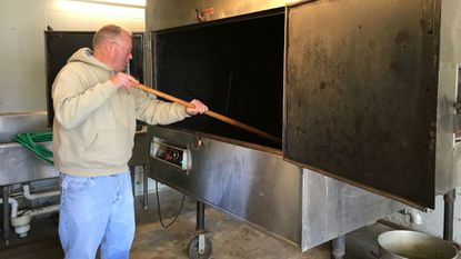 Fred Wills cleans the rotisserie at the Joseph L. Davis American Legion Post 47, where more than 100 turkeys will be cooked early next week in preparing for the annual Thanksgiving dinner at the Havre de Grace Community Center on Nov. 22.